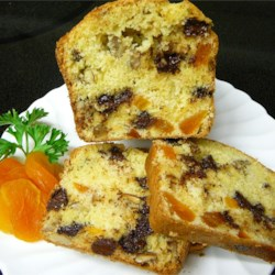 Apricot Orange Bread Recipe - Orange juice and dried apricots blend into a fruity sensation in this quick bread.  A scattering of chocolate chips makes a perfect finish.