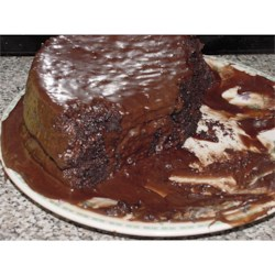 Chocolate Pudding Fudge Cake Recipe - This chocolate cake is very easy to make and even easier to eat! Chocolate cake mix, chocolate pudding, chocolate chips and sour cream make this cake extremely moist and irresistible!