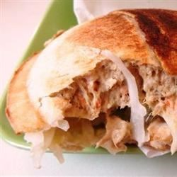 Tuna Pockets Recipe - Savory tuna filling is baked in refrigerated biscuit dough to make quick, easy tuna salad pockets that are perfect for your lunchbox.