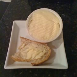 Homemade Butter Recipe - We have made this recipe a Thanksgiving Day tradition in our family since my son was in kindergarten. Open the container and -- voila! -- you have homemade butter. Pour off the buttermilk (or drink it if you like)and place the butter in a serving dish. Great on dinner rolls. The little ones will be proud to have helped prepare the meal.