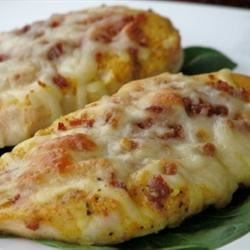 Easy Honey Mustard Mozzarella Chicken Recipe - Chicken is glazed with mustard and honey, then baked with bacon and cheese. A favorite!