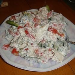 Russian Tomato Salad Recipe - This simple sweet onion, tomato, and green pepper salad is cool, creamy, and delicately seasoned with fresh dill.