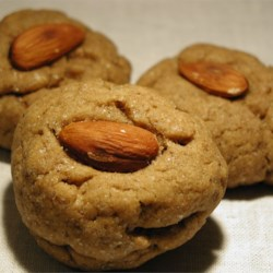 Drommar Recipe - These Swedish 'dreams' are browned-butter cardamom cookies, each topped with a blanched almond.