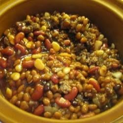 Calico Bean Soup Recipe - Four kinds of beans and two kinds of split peas are cooked with a smoked ham hock, and flavored with dried onion and cumin in this soup, the dry mix for which can also be made in a jar and given as a gift.