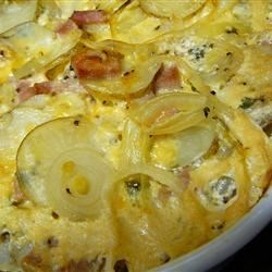Easy Cheese and Ham Scalloped Potatoes Recipe - Made with buttery Yukon Gold potatoes, Cheddar cheese, and ham, these scalloped potatoes are rich, creamy, and deceptively simple! This is an easy make-ahead recipe for a potluck or holiday meal.