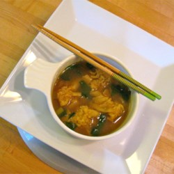 Weeknight Wonton Soup Recipe - Made with prepared broth, frozen wontons and vegetables, this quick, Chinese inspired soup is a simple and filling dish any night of the week.