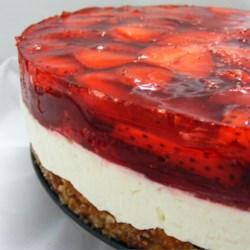 Judy's Strawberry Pretzel Salad Recipe - This three-layer salad includes a pretzel crust, cream cheese center, and strawberry top.