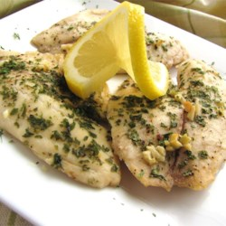 Lemon Garlic Tilapia Recipe - Tilapia fillets are bathed in lemon juice and melted butter, seasoned with garlic and parsley, and baked to flaky perfection.