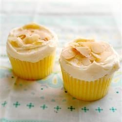 Lemon Cupcakes Recipe and Video - These light, lemony cupcakes, made from scratch, have a fluffy whipped cream icing.