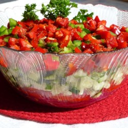 Sweet and Sour Veggies Recipe - Cucumbers, colorful bell peppers, tomatoes, and red onion star in this tangy salad. Let the veggies marinate for four hours or overnight for the best flavor.