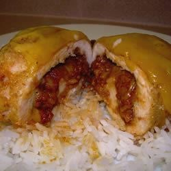 Southwestern Chicken Roulade Recipe - Monterey Jack cheese, masa harina, and sweet yet mildly spicy chorizo sausage offer unique Southwest flavors to stuffed, baked chicken breasts.