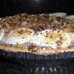 Banana Split Pie Recipe - Butter, confectioners ' sugar, eggs, and a bit of vanilla are creamed together and combined with grated chocolate and sliced bananas. This lovely concoction is then spooned into a baked pie shell and garnished with whipped cream and nuts.