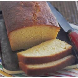 Zesty Lemon Loaf Recipe - This dressed-up pound cake-style lemon loaf has a delicate hint of ginger. The decadence of Grand Marnier makes this lemon loaf special. Great with Earl Grey tea or ice wine.
