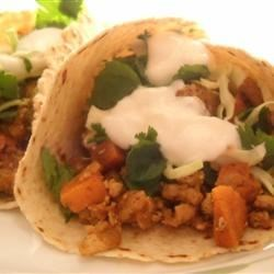 Turkey and Yam Spicy Tacos Recipe - Spicy tacos with low fat turkey have a sweet-hot flavor, yams give them a surprising twist.