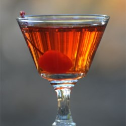 Shaggy's Manhattan Recipe - Bourbon and sweet vermouth - shaken with ice, strained into a cocktail glass and garnished with a cherry.