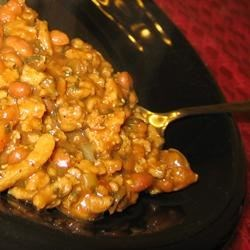 Yoyo's BBQ Beans Recipe - Use a shortcut--open a can of pork and beans--to make this zesty barbecued bean dish fast and easy. Seasonings for the ground beef, onions and beans mixture include mustard, brown sugar, garlic and onion powders, Worcestershire sauce, and barbecue sauce