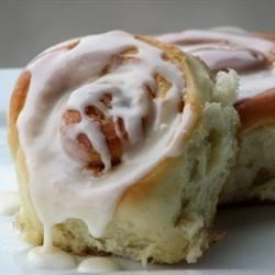 Soft, Moist and Gooey Cinnamon Buns Recipe - Vanilla pudding mix in the yeast dough gives a sweet, distinctive taste to these bread machine rolls oozing with butter laced with brown sugar and cinnamon.  A vanilla-tinged glaze tops them off perfectly.