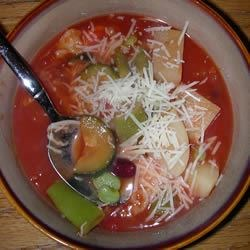 Easy Vegetable Soup I Recipe - Use up those cans of veggies and beans and cook up a soup so delicious that you could call it magic! This lovely tomato-based vegetable soup takes only 30 minutes to prepare.