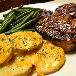 Grilled Brown Sugar Pork Chops Recipe - Grilled pork chops are basted with a sauce made with apple juice, brown sugar, and ginger.