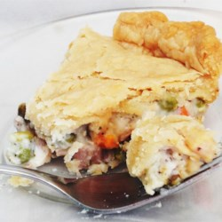 Dad's Leftover Turkey Pot Pie Recipe - Left over turkey meat joins forces with peas, carrots, and green beans in a savory pot pie. The recipe makes 2 pies to feed a good-sized family or to have a pie for later.