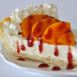 Peach Surprise Pie Recipe - This no-bake pie has a wonderful combination of flavors. Sweetened cream cheese is spread in the bottom of the pie shell, sliced peaches arranged on top, and raspberry preserves, with a bit of lemon juice stirred in, is spooned over the top.