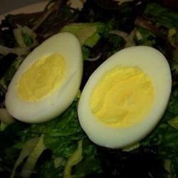 Perfect hard boiled eggs on salad