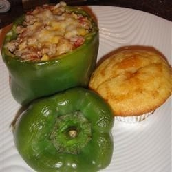 Feta and Turkey Stuffed Green Peppers Recipe - Ground turkey seasoned with rosemary, thyme, and fennel is mixed with barbeque sauce and rice to make a filling for green bell peppers in this version of the classic dish.