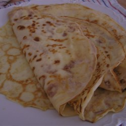 French Crepes Recipe - These French crepes are thin and delicate pancakes that can be filled with anything you like, such as fresh fruit, chocolate sauce, and whipped cream.