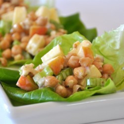 Garbanzo Bean Salad Recipe - Great textures and tastes in this salad of chickpeas, chopped apples, and nuts. A creamy honey-mustard dressing adds yet another taste dimension.