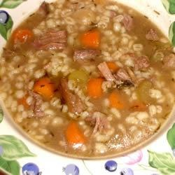 Beef and Barley Soup I Recipe - Meaty beef soup bones are combined with vegetables, a removable spice bag, barley and 12 cloves of garlic in this simple-to-prepare soup which needs 8 hours to cook in a slow cooker.