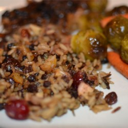 Rice Stuffing with Apples, Herbs, and Bacon Recipe - Dried mixed herbs, dried fruit, and bacon instill a blend of two rices with a magnificent array of flavors!