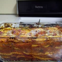 Lazy Lasagna II Recipe - A simple version of lasagna using cheese ravioli, browned beef, onion and plenty of mozzarella cheese.