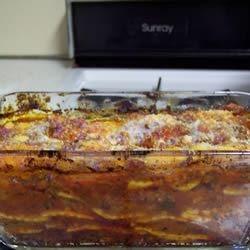 Lazy Lasagna II Recipe - A simple version of lasagna using cheese ravioli, browned beef, onion and plenty of mozzarella cheese.