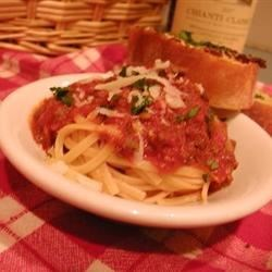 Bolognese Sauce with Meat Recipe - Prosciutto and ground beef give hearty flavor to a delicious simmer of roma tomatoes, garlic, onion and tomato paste. Add dollops of butter to the sauce for a rich finish.