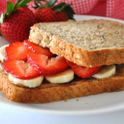 Deluxe Almond Butter Sandwiches Recipe - Made with banana and strawberries, this sandwich is a meal.