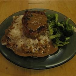 Southern-Style Pork Chops Recipe - Pork chops are coated with onion soup mix and pan fried before being simmered in a white wine and cream sauce in this tasty main dish.