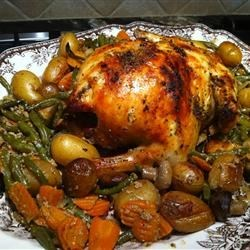 Bacon Roasted Chicken Recipe - My family loves this chicken!  It is always so tender and moist and is a perfect Sunday dinner.  The bacon helps to 'baste' the chicken while it cooks.  Recipe can be adjusted to any size whole chicken.