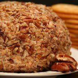 Easy Cheese Ball II Recipe - Ranch dressing mix lends an herb-y tang to this cream cheese and cheddar combo; the crunch comes from chopped pecans.