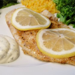 Hudson's Baked Tilapia with Dill Sauce Recipe - Baked tilapia seasoned with Cajun and citrus served with a creamy sauce of fresh dill and lemon.