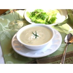Classic Vichyssoise Recipe - A delicious leek and potato soup enriched with a little fresh cream. Serve warm or cold.