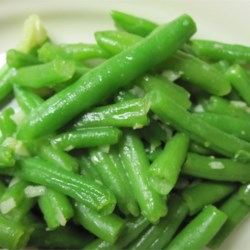 Garlic Green Beans Recipe - Caramelized garlic and cheese! Is there anything better with green beans? You'd better make plenty for everyone!