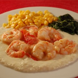 Lowcountry Shrimp and Cheese Grits Recipe - Succulent shrimp sauteed with diced tomato in olive oil and butter, served over garlic cheese grits.