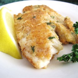 Almond-Crusted Tilapia Recipe - Tilapia is coated with ground almonds and Parmesan cheese in this delicious dish.