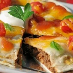 Jimmy's Mexican Pizza Recipe and Video - Jimmy's specially seasoned ground beef, refried beans, salsa, and cheese layered between two flour tortillas for a Mexican inspired deep dish pizza.