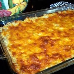 Company Potatoes Recipe - Hash brown potatoes are combined with potato soup, celery soup, sour cream, milk, onion and dill, and topped with Cheddar cheese.  This is a rich and creamy dish you'll want to serve again and again!