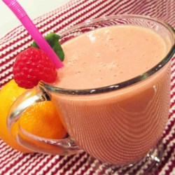 Sunshine Juice Recipe - This creamy but creamless raspberry-orange-banana juice makes a smooth and colorful start to the day.