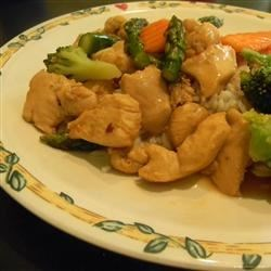 Orange Chicken Stir Fry Recipe and Video - Chicken morsels are treated to a quick stir fry in a light, delectable orange-soy sauce and served over crispy chow mein noodles.