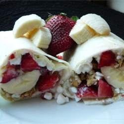 Good Morning Wrap Recipe - Wrap a banana, some cottage cheese, granola, pineapple and brown sugar in a tortilla, and take your breakfast with you.