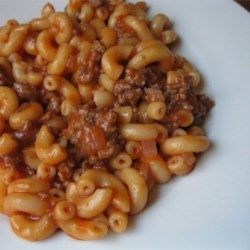American Chop Suey II Recipe - This is an old family recipe. My family loves it. It's quick and easy. Elbow macaroni and ground beef are combined in a tomatoey sauce. The kids will eat this one!