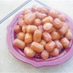 Drunken Dogs Recipe - These dogs are made with beer and brown sugar, but are always a big hit with our friends and family. They should simmer on the stove for at least 60 minutes. We usually put them in a slow cooker when serving to keep them hot. Use toothpicks to spear these little bit-sized delights.
